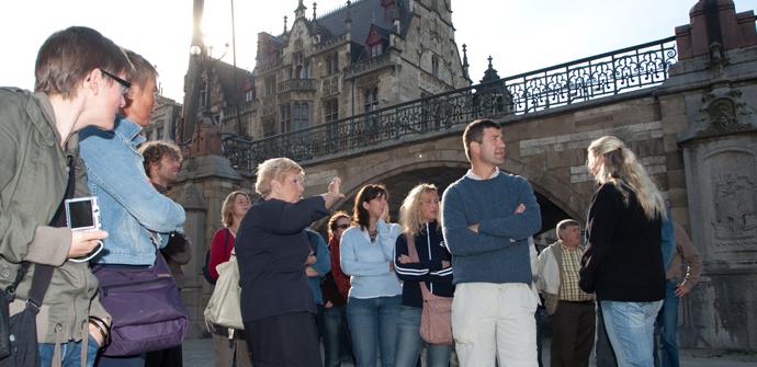 Rondeleiding Gentse Gidsen aan de Sint-Michielsbrug op de Graslei